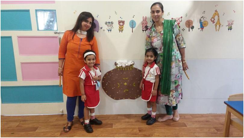 VES DBC Nursery students, Celebrating Janmashtmi by group activity of decorating the matki, with Teachers.